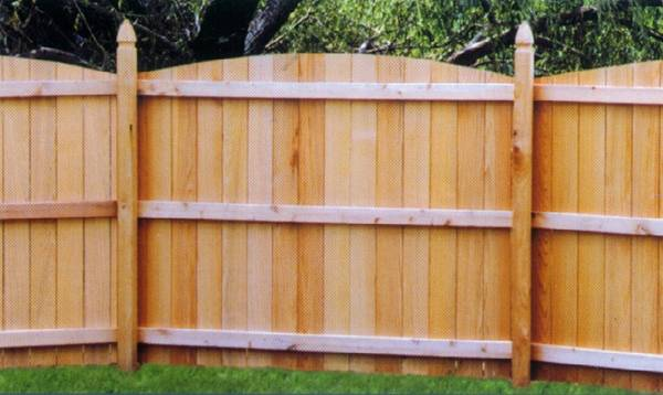 Metropolitan Fence Custom Builds Board on Board Scalloped Convex Wood Privacy Fences in Milwaukee and Waukesha Wisconsin